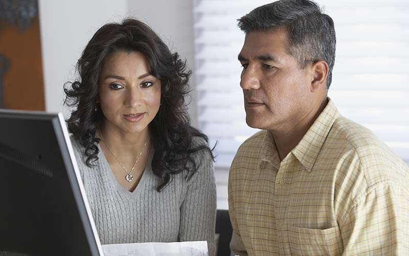 man-and-woman-concerned-about-checking-their-credit-scores